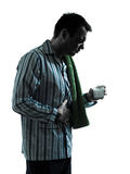 Man pajamas taking medicine effervescent stomach ache pain Royalty Free Stock Photography