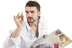 Man with palette. Painter with brush and palette. Isolated over white Stock Photography
