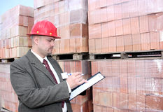 A man with pallets of bricks royalty free stock photo