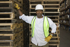 Man By Pallets In Warehouse Stock Photos
