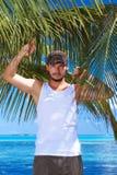 Man on Palm Stock Photo