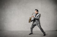 Man palying the sax Stock Images