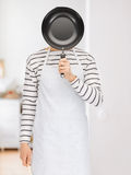 Man with pan at kitchen Royalty Free Stock Photo