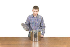 Man with a pan Royalty Free Stock Image
