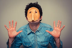 Man with pancake on his face Royalty Free Stock Photography