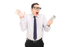 Man panicking over an empty toilet paper roll Royalty Free Stock Images