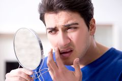 The man panicking because of pimples on the skin. Man panicking because of pimples on the skin royalty free stock photography