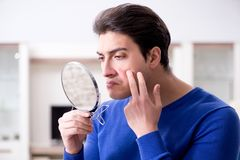 The man panicking because of pimples on the skin. Man panicking because of pimples on the skin stock images