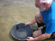 Man panning for gold Royalty Free Stock Image