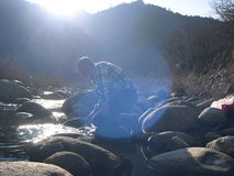 Man panning for gold. Royalty Free Stock Images