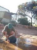 Man panning for gold in Western Australia. Stock Photos