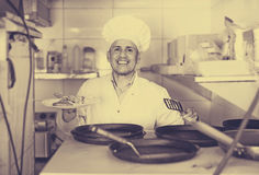 Man  with pans with kebab plate Stock Image
