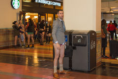 A man without pants in the Union Station during the. Los Angeles, CA - January 11, 2015: A man without pants in the Union Station during the 7th Annual Royalty Free Stock Photography