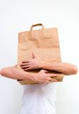 Man with paper bag in hands Royalty Free Stock Image