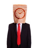 Man with a paper bag on head clock dial on it Stock Photography