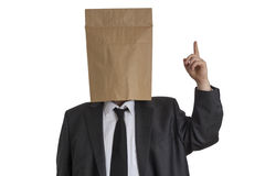 Man with Paper Bag on his head pointing upwards Stock Photography