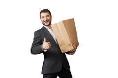 Man with paper bag showing thumbs up Stock Photography