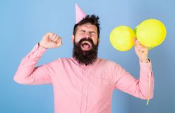 Man in paper cap isolated on blue background. Daddy exhausted after day with kids, International children day. Celebration. Hipster with trendy beard yawning stock photos