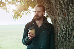 Man with paper cup of morning coffee Stock Image
