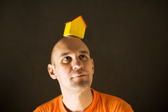 Man with paper house Stock Photo