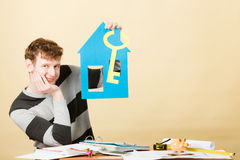 Man with paper house and key. Royalty Free Stock Photo