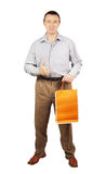 Man with paper package for purchases Royalty Free Stock Photos