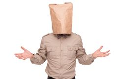 Man with paper packet on head Royalty Free Stock Image