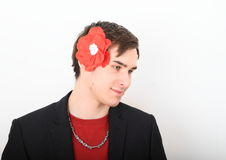 Man with paper rose in hair Stock Photos
