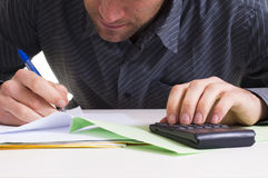 Man and paper work Royalty Free Stock Images