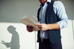 Man with papers Stock Photo
