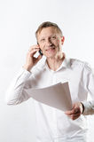 Man with papers on the phone Royalty Free Stock Photos
