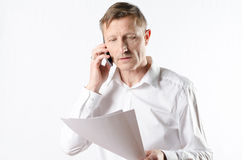 Man with papers on the phone Stock Photography