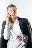 Man with papers on the phone Royalty Free Stock Images