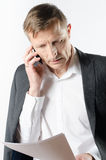 Man with papers on the phone Stock Images