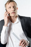 Man with papers on the phone Stock Image