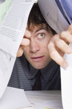 Man and paperwork Royalty Free Stock Images