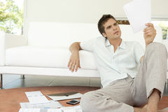 Man with Paperwork Sitting on Floor Royalty Free Stock Photography