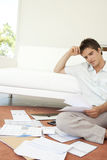 Man with Paperwork Sitting on Floor Royalty Free Stock Image