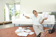 Man with Paperwork Sitting on Floor Royalty Free Stock Images