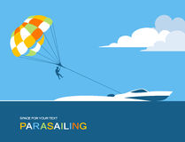Man para sailing with parachute behind the motor boat Stock Photos