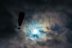 Man Paragliding Under Gray Sky Stock Image