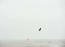 Man Paragliding Under White Cloudy Sky during Daytime Royalty Free Stock Photography
