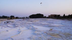 Man on Paraplane is flying over Pamukkale, natural site in Denizli Province in southwestern Turkey. 4k UHD stock video footage