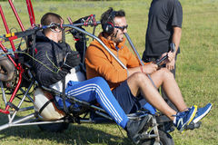 Man with paraplane. JUNE 20, 2017: Assistant helps the paraglider to straighten the paraplane before the flight in Bulgaria Stock Images