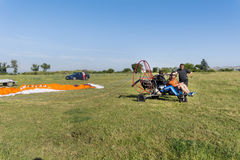 Man with paraplane. JUNE 20, 2017: Assistant helps the paraglider to straighten the paraplane before the flight in Bulgaria Stock Photo