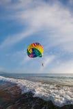 Man is parasailing stock photography