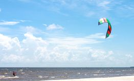 Parasailing in the Gulf of Mexico with beautiful blue sky and white sand stock photography