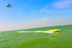 Man parasailing and speedboat Royalty Free Stock Images