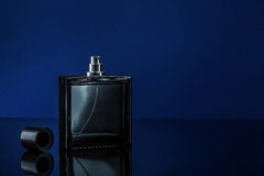 Man parfume. Men's parfume on a dark blue background stock image