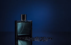 Man parfume. Men's parfume on a dark blue background royalty free stock photos